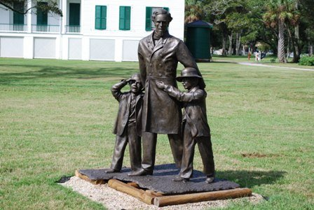45 Davis Statues with his kids Jim Limber black adopted son