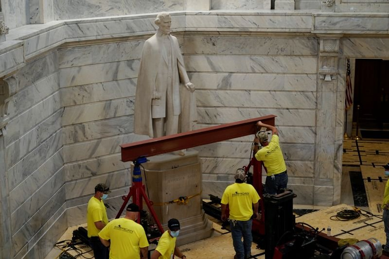 Workers prepare to remove a statue of Confederate President Jefferson Davis from the State Capitol in Frankfort