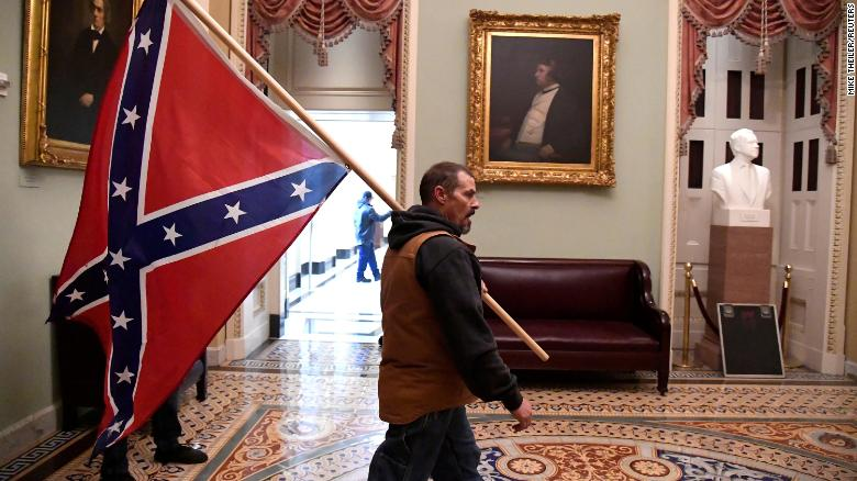 Why The One Man with the Confederate Flag out of the thousands Carrying different Flags at the US Capitol protest and breach is NOW the most famous out of all?